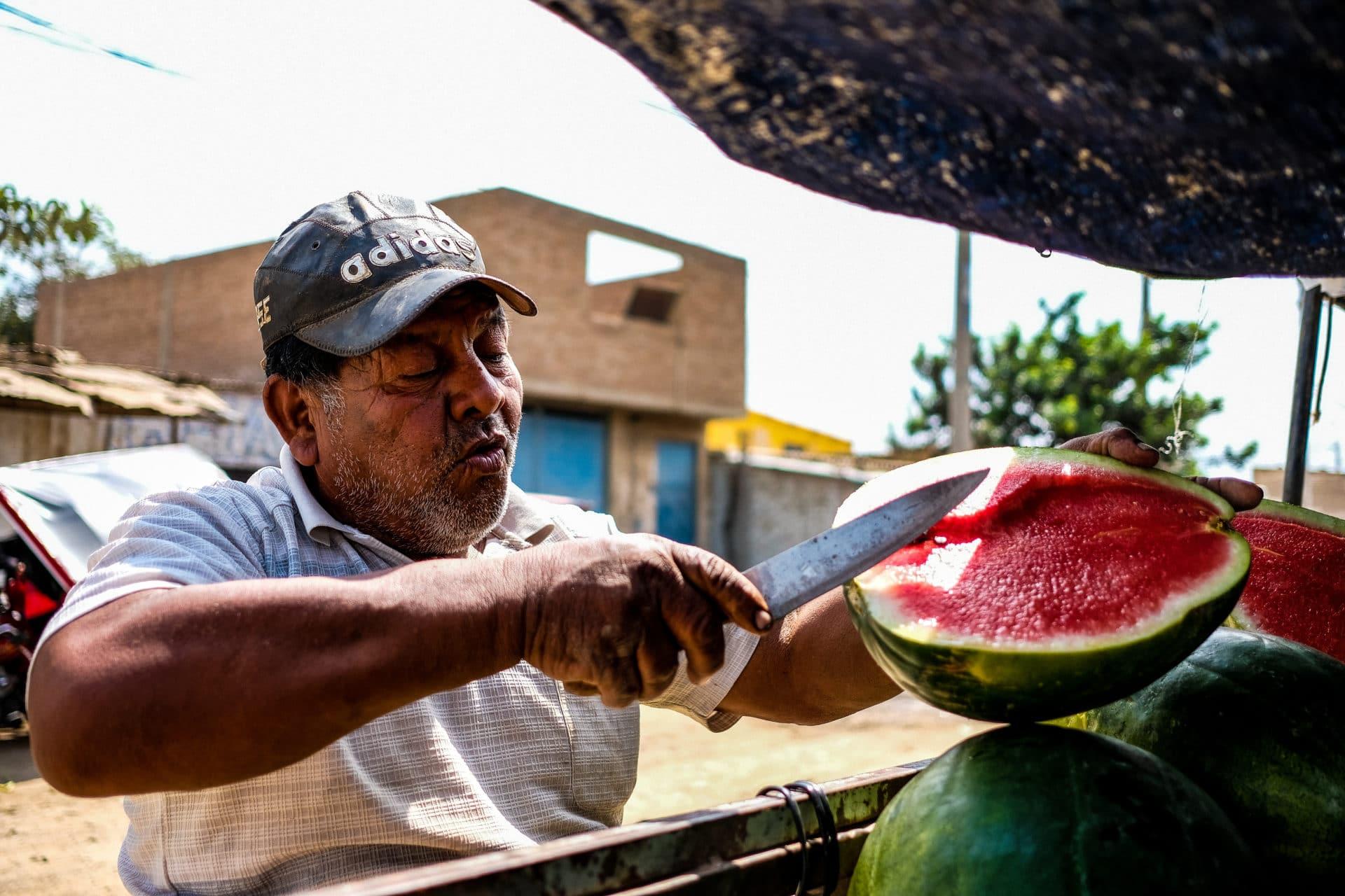 Man Cutting Watermellon-2