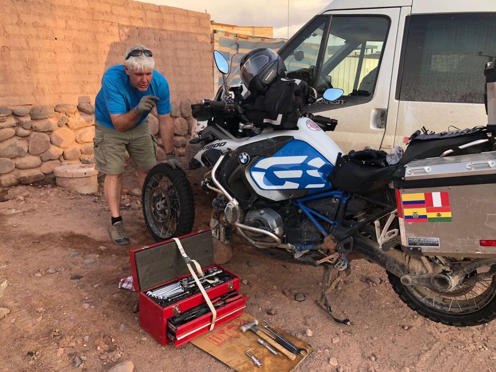 Ollie repairing phils bike
